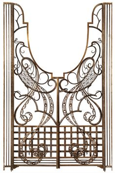 PAUL KISS pair of hammered wrought iron interior gates with stylized peacocks. Circa 1925. 90-1/2 in.