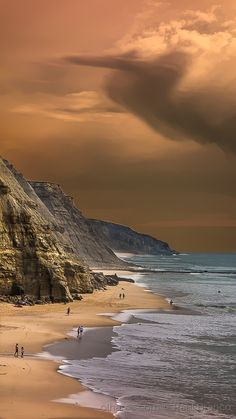 We usually post U.S. beaches, but this one in Portugal is so beautiful, we made an exception! Praia de Sao Juliao - photo by Raul Branco
