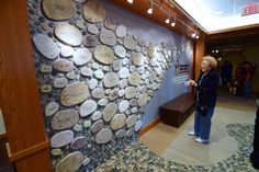love this donor wall, continuation of rock river theme in confluence building