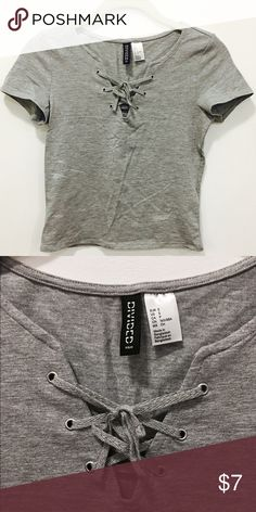 H&M Cropped top Grey lace up cropped top. Very stretchy.  Perfect for high waist jeans and skirts. NWOT H&M Tops Crop Tops
