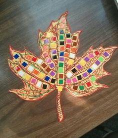 We're making Fall Mosaics with leaves or pumpkins now through 11/26/2014.