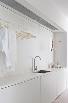 And, the editors' favorite feature of this sleek, streamlined laundry room is none other than a clever Ikea hack. See if you can spot it, then read more in Design Sleuth: One of the Most Ingenious Ikea Hacks Ever. Photograph by Shannon McGrath. Ikea Laundry Room, Laundry Room Storage, Ikea Utility Room, Modern Laundry Rooms, Laundry Area, Small Laundry, Küchen Design, House Design, Interior Design