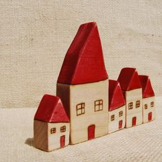 Odd bods wooden houses by Woodmouse on etsy.