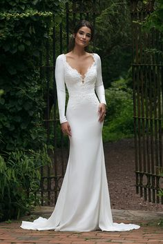 Sincerity Bridal Style 44045 - Long sleeve crepe wedding dress.  Elegant wedding dress with crepe sleeves and illusion back.  Fit and flare crepe wedding dress. Meghan Markle inspired wedding dress.