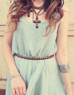Sheer dress  with cute necklaces and belt.
