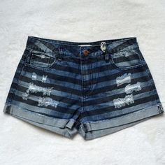 """Destroyed denim shorts F21 denim shorts with stripe wash, destruction on front pocket areas and small destruction on the back pocket, belt loops, cuffed hem, zipper and button closure. Measurement - waist - 14"""", length - 11"""", inseam- 2"""".Item measured laying flat on the ground. Forever 21 Shorts Jean Shorts"""
