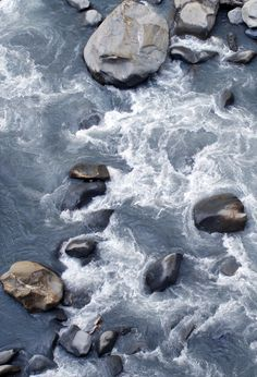 water swirling around rocks