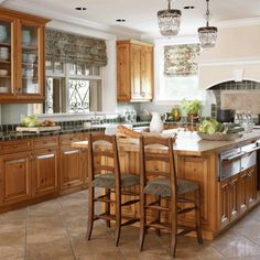 Elegant Kitchens with Warm Wood Cabinets http://www.traditionalhome.com/kitchens/elegant-kitchens-warm-wood-cabinets  Design Detective is ready to help you! Just give us a call. Call à la carte DESIGN 303.885.7706