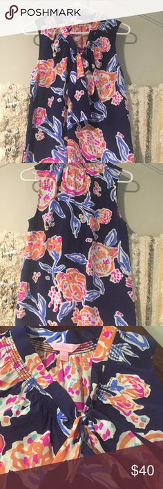 Lily Pulitzer silk top Lily Pulitzer silk v-neck top with bow tie 100% silk size small  like new condition, from a smoke free home Lilly Pulitzer Tops