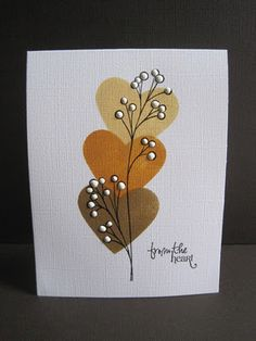 I used a Stampin Up heart punch punched through a scrap piece of typing paper and sponged the heart with 3 colors of Ranger distress inks(Scattered Straw, Wild Honey,Brushed Corduroy). I stamped the stem in Early Espresso and dotted with white Enamel Accents.** those r the instructions to make the card.. I am thinking of another project though, so for me this is for inspiration