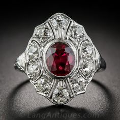 https://www.bkgjewelry.com/sapphire-pendant/922-18k-white-gold-blue-sapphire-elephant-pendant.html Art Deco Ruby and Diamond Dinner Ring. A resplendent Jazz Age jewel from the roaring 'twenties starring a bright, brilliant red ruby, weighing one-and-a-third carats. The radiant gemstone is is embellished all around in a geometrically sectioned frame sparkling with ten bright white, high-quality European-cut diamonds, totaling 1.25 carats. This impressive Art Deco dazzler sits low on the…