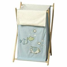 "Perfect for a child's room or bathroom, this charming laundry hamper features a folding frame and delightful fish motif.  Product: HamperConstruction Material: Wood and fabricColor: Natural and blueFeatures:  Stand folds flat for storageRemovable inner linerDimensions: 26.5"" H x 15.5"" W x 16"" DCleaning and Care: Machine washable"