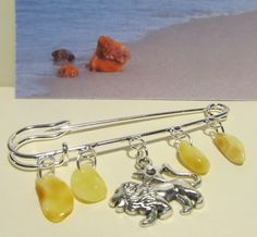 https://www.etsy.com/listing/453250410/100-natural-baltic-genuine-amber-brooch?ref=shop_home_active_46  http://amberwizard.eu/  Natural Baltic Amber BROOCH YELLOW BEADS  Zodiac Sign AUGUST LEO  BRACELET BROOCH PENDANT  yellow cognac
