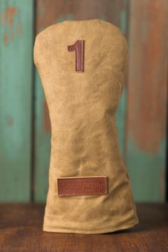 Made using The American Duck Canvas material, is heavy and very protective. These Headcovers will develop a natural distressed look over time which makes every headcover personal to its owner.  The Headcovers are made with a water-resistant Waxed Cotton Canvas, lined with Premium Fleece, has fully tapered seams for added water-resistance and has a premium Vegetable tanned leather number