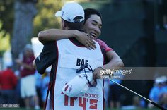 Sang-Moon Bae of South Korea hugs his caddy on the 18th green after winning the Frys.com Open at Silverado Resort and Spa on October 12, 2014 in Napa, California.
