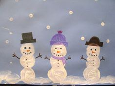 Painting snowmen with marshmallows