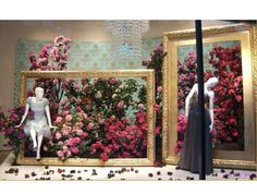 Type: closed Props: mannequins, flowers, picture frames, chandelier Lighting:spotlight, general Colors: red, pink, red-pink, white, black, gold, green blue Line: vertical, horizontal Shape: rectangles Balance: asymmetrical Emphasis: flowers