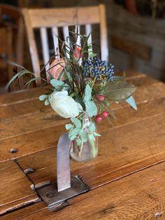 Old Mill Wedding, old stonework. Locally sourced wedding. Locally grown flowers. Burgundy, peach, coral,creams, ranunculus, gomphrena and blue viburnum.