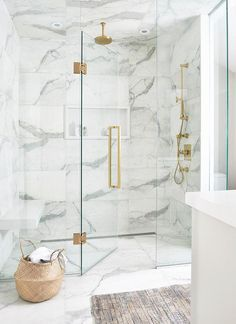 Luxurious white and gray marble shower with a white niche enclosed with glass doors and brass hardware. Luxurious white and gray marble shower with a white niche enclosed with glass doors and brass hardware. White Marble Bathrooms, Marble Showers, Small Bathroom, Bathroom Ideas, Bathroom Organization, Master Bathroom, Bathroom Showers, Bathroom Plants, 50s Bathroom