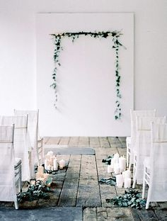 simple backdrop, candles and greens along the aisle