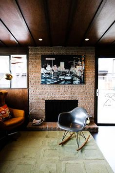 The Craver Compound | House Tour, from Apartment Therapy: Great example of a fireplace in a mid-century modern home.