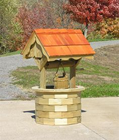 Amish Garden Wishing Well with Cedar Roof - Medium LuxCraft Wood Furniture Collection The charm of our Amish Garden Wishing Well with Cedar Roof-Medium will draw the eye and warm the heart! &