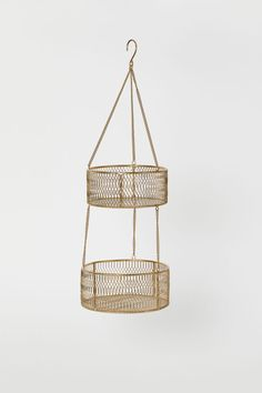 Hanging basket in metal wire with two levels linked by chains with hanger hook at top. Small basket height 3 in. diameter 7 in. Large basket height 3 in. diameter 8 in. Tiered Fruit Basket, Hanging Fruit Baskets, Large Baskets, H & M Home, Kitchen Baskets, Hanger Hooks, Diy Furniture, Leather Furniture, Home