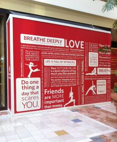 Construction wall advertising for a new LuLu Lemon store that's coming soon.