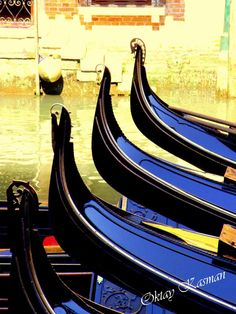 Four Venice Gondolas hanging about on a canal