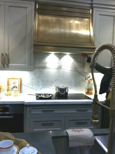 range hood - this hood isn't brass but a painted finish on wood