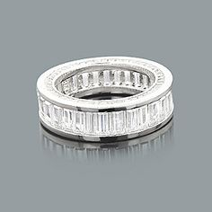 Large Baguette Diamond Eternity Band - Made in New York - features 6.20 carats of channel-set diamonds. This diamond eternity ring is available in Platinum, 18k or 14k yellow, rose, white gold, various sizes, and can be customized with any color and quality diamonds. Price and description is for a ring in 14k gold and size 6. Please note: it will take us 3-5 business days to make this ring for you, so please plan accordingly.