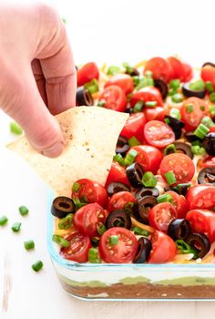 The best classic 7 layer taco dip made with fresh ingredients. Colorful, healthy, and delicious, this Mexican layer dip recipe is always a hit at any party! 7 Layer Taco Dip, Layered Taco Dip, Layer Dip, Appetizer Dips, Appetizers For Party, Appetizer Recipes, Party Dips, Guacamole, Avocado Hummus
