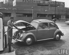 Gas station attendent pumping gas for customer driving a German Volkswagan automobile as Henry Hudson Parkway & the Department of Sanitation bldg. Volkswagen Models, Car Volkswagen, Vw Cars, Volkswagon Bug, Vw Camper, Van Vw, Vw Classic, Vw Vintage, Vintage Photos