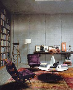 Concrete walls, rugs, book shelf, study, living room