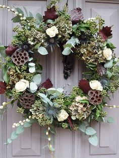 Hanging door wreath at the entrance of the reception venue? Withe red grandprix … Hanging door wreath at the entrance of the reception venue? Withe red grandprix roses, berries, whites,berries, golds etc. Christmas Flowers, Noel Christmas, Christmas Crafts, Christmas Decorations, Christmas Flower Arrangements, Christmas Movies, Christmas 2019, Christmas Ornament, Christmas Wreaths For Front Door