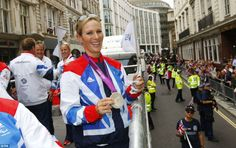 vRoyal appeal: Zara Phillips, who won a silver medal in the team eventing, waved to fans from a float carrying the equestrian teams. She said the parade as: 'Unbelievable, to think that everyone's come out for all of us'