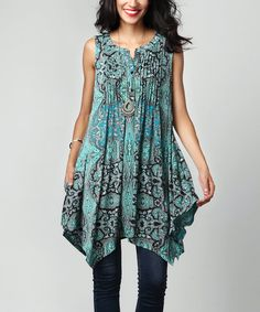 Add pizzazz to everyday looks with this tunic that features a standout pattern. The relaxed cut promises daylong comfort. Note: This is a one-of-a-kind item; prints may vary.