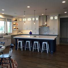 White Kitchen with Navy Blue Island. Kitchen with white cabinets and navy kitchen island. #NavyIsland #NavyKitchenIsland #NavyBlueKitchenIsland Candance Homes. Four Chairs Furniture & Design.