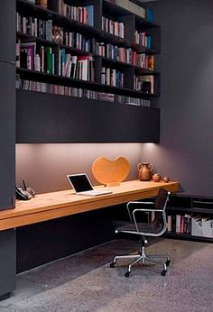 I like this office because it is simple and there isn't much for him to get distracted by. However, there is a nice built in book shelf over head which is a good idea to save space.