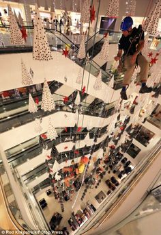 The technicians abseiled the John Lewis Oxford Street store's high atrium as teams of 30 busily worked overnight to transform stores into a festive win...