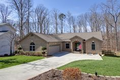 319 Oostanali Circle | Tellico Village | MLS#879518 $394,500   Lovely quality-built home in golf neighborhood. Special features include 3 BRs (split) on main, beautiful custom cabinetry, built-in china&/buffet in DR & BkR & audio/video cab. in GR, 3/4''tongue & groove hdwd flooring, crown molding and 6'' baseboards throughout, 2 fireplaces, 2 50 gal. water heaters, 2 heat pumps with propane auxillary heat, humidifier,