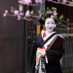 She must be a maiko - apprentice geisha