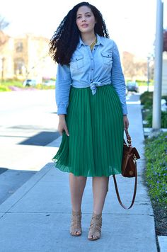 love this girls eye for great outfits. Love how this pleated midi skirt is paired with sandals and a denim shirt.