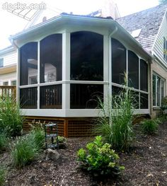 Screen Porch with lattice skirting-white on top, wood on the bottom