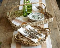 {via Williams Sonoma} Baskets can be used at indoor and outdoor buffets alike to hold dishes, flatware, napkins or even food.