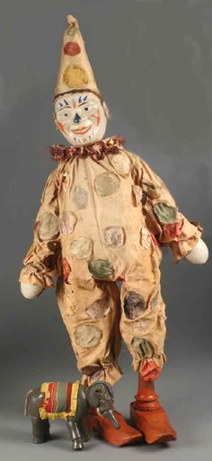 Point-of-Sale Clown  This clown, at about 45 inches tall, is likely the largest clown that Schoenhut ever made. It was custom built for use in large point-of-sale displays. Imagine seeing him in Macy's toy department around 1910.