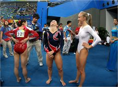 Shawn Johnson waiting to receive her beam gold medal at the 2008 Olympic Games. With Cheng Fei and Nastia Liukin.