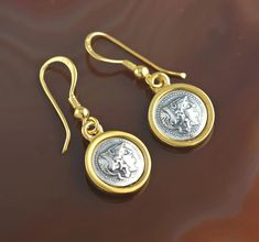 Unique earrings with ancient coins representing the fearless Athena - the Greek goddess of wisdom, courage, justice, and crafts.  For a bold, strong, courageous woman - like you.  The earrings are available in my Etsy shop - link in bio.  #greekgoddess #greekjewelry #coinjewelry #greekmythology #femininepower