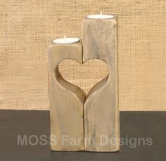 Looking for the perfect gift or that special piece of home decor that symbolizes the love in your family. These rustic heart linked candle holders will look great in any decor. Each candle represents a different family member, all linked together with love. (Candles can be used separately) Dimensions: Main candles: 2 x 2 x 8 and 2 x 2 x 6.5 The additional candles are : 2 x 2 x 5.5, 5, 4.5, 4, 3.5 White tea light candles are included. This item is made to order. The grains, knots and char...