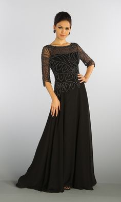 Long A-line 75D Chiffon dress with stunning beaded bodice and short sleeves. Illusion beaded neckline and center back zip closure. This evening gown is perfect for mother of the bride. Available in black and champagne colors.